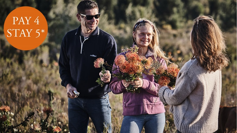 3 People in the fynbos smiling