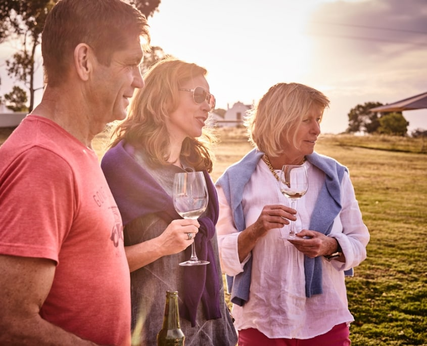 3 People with a glass of southafrican wine